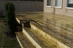 Green pressure treated wood deck