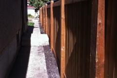 Edmonton Fence Brown pressure treated wood fence