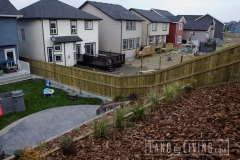 Pressure treated fence up hill 2