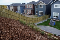 Pressure treated fence up hill