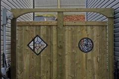 Pressure treated gate with metal ornaments