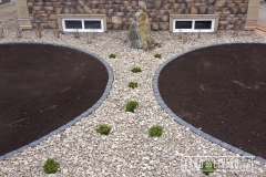 Edmonton Landscaping River rock and paving stone edger